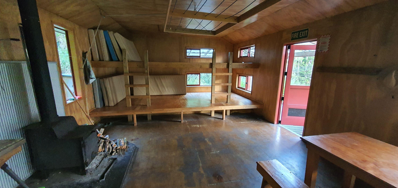 Herepai & Roaring Stag Huts by John Alexander