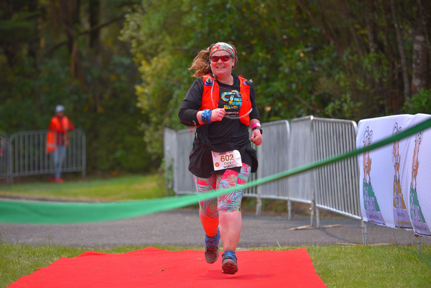 All smiles crossing the finish line at The Goat. Photo credit: Photos4Sale